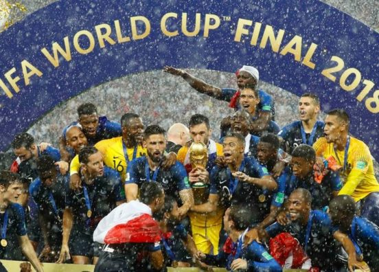 France lift the World Cup among a torrent of rain and golden ticker tape.