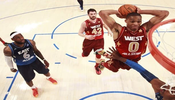 West All-Stars Russell Westbrook of the Oklahoma Thunder dunks as East All Stars LeBron James and West's Kevin Love looks on