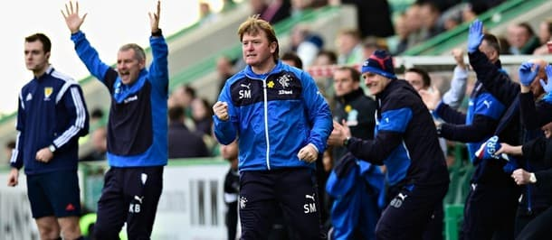 The Rangers manager Stuart McCall pumps his fist as his side take the lead against Hibs.
