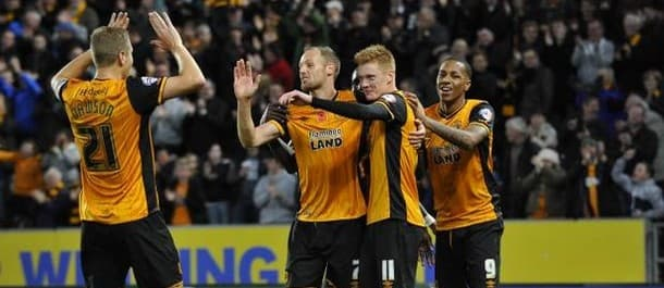 Hull beat Middlesbrough 3-0 to go top of the table.