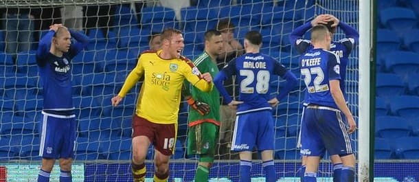 Cardiff players look on in disbelief as Burnley complete a late comeback.