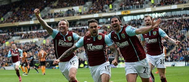 Burnley top the Championship after four consecutive wins.