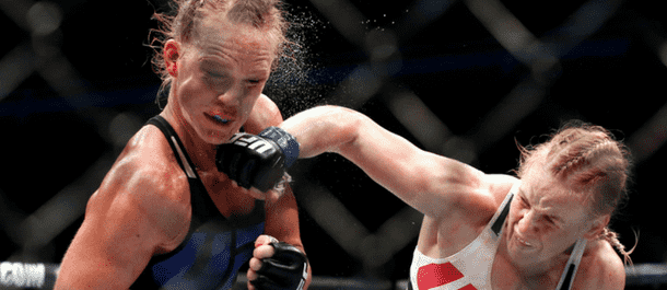 Valentina Shevchenko lands a punch on Holly Holm