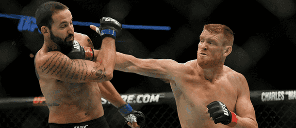 Sam Alvey lands a heavy punch on the chin of Alex Nicholson