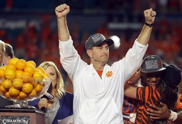 Clemson coach Dabo Sweeney celebrates his school's comeback, upset win over Alabama.