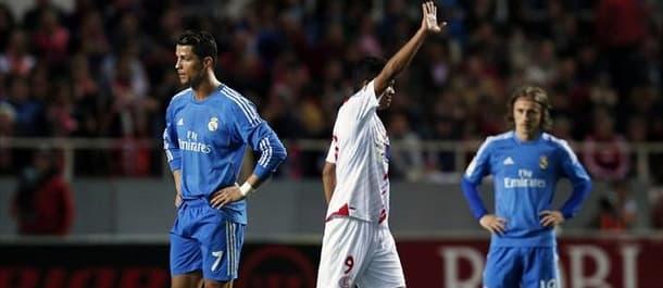 Sevilla beat Real Madrid 2-1 to end their unbeaten run.