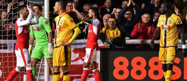 Arsenal beat non-league Sutton 2-0 in the last round of the FA Cup.