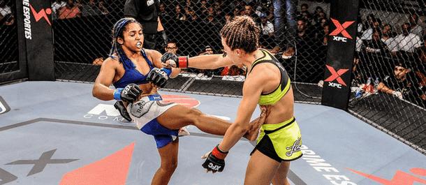 Viviane Pereira kicks her opponent