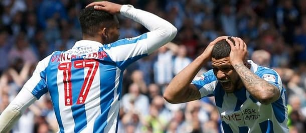 Sheffield Wednesday held Huddersfield to a draw in the first leg of the play off semi final.