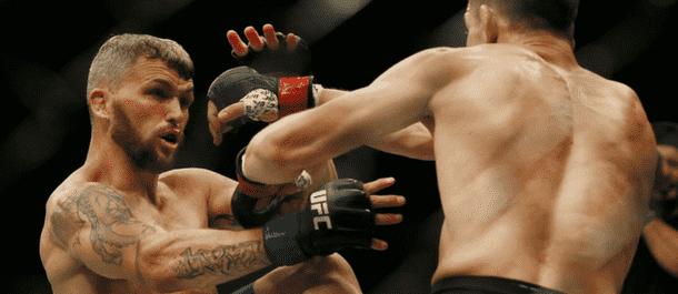 Jon Tuck Strikes at Damien Brown