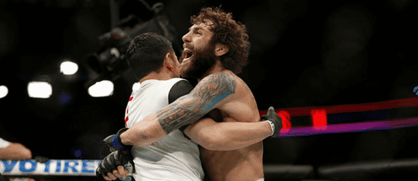 Michael Chiesa Celebrates after defeating Beneil Dariush