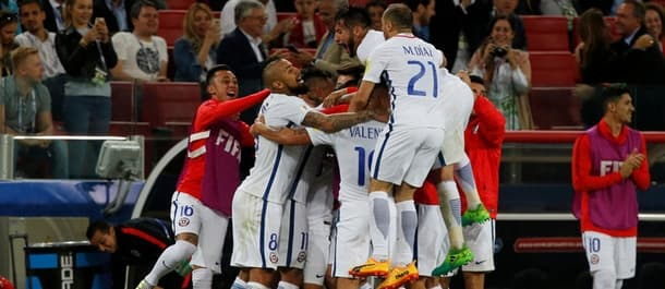 Chile beat Cameroon 2-0 in their Confederations Cup opener.