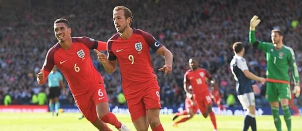 Harry Kane rescued a point for England against Scotland.