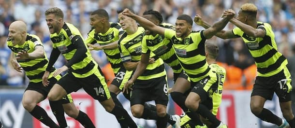 Huddersfield players celebrate promotion to the Premier League.