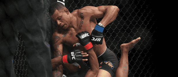 Alex Oliveira connects with some ground and pound on Tim Means