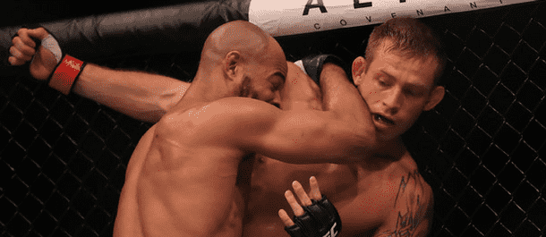David Branch pushes Jotko to the cage