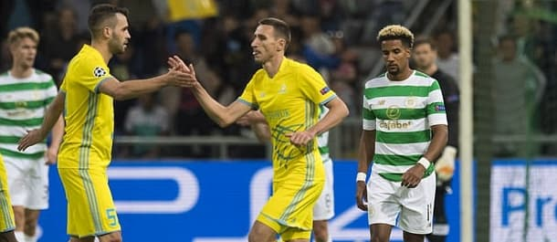 Astana beat Celtic 4-3 at home in a Champions League qualifier.