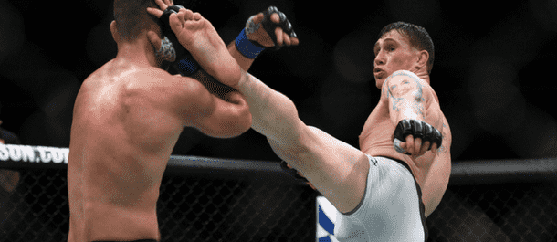 Darren Till slams a kick into Jessin Ayari - now gets ready for Donald Cerrone