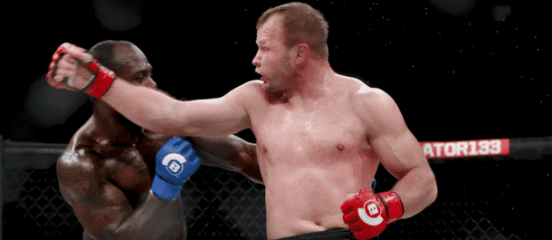 Title Alexander Shlemenko spinning back fist at Bellator