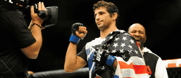 Beneil Dariush celebrates with USA flag