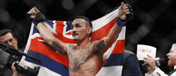 Max Holloway celebrates after defeating Jose Aldo