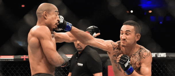 Max Holloway lands a heavy shot on Jose Aldo