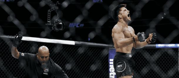 Henry Cejudo celebrates a UFC victory