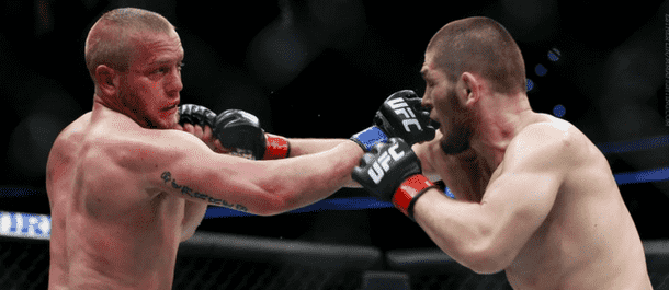 Darrell Horcher exchanges fists with Khabib Nurmagomedov