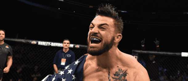 Mike Perry celebrates after UFC win