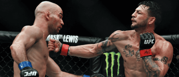 Cub Swanson connects with a left hook on Artem Lobov