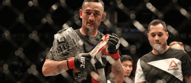Max Holloway celebrates winning the UFC featherweight championship