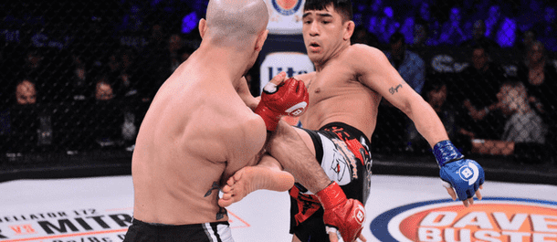 Emmanuel Sanchez kicks his opponent in Bellator