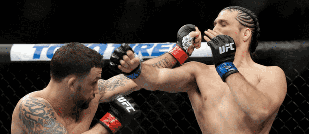 Frankie Edgar lands a shot on Brian Ortega