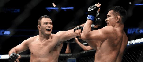 Gian Villante throws a punch inside the Octagon