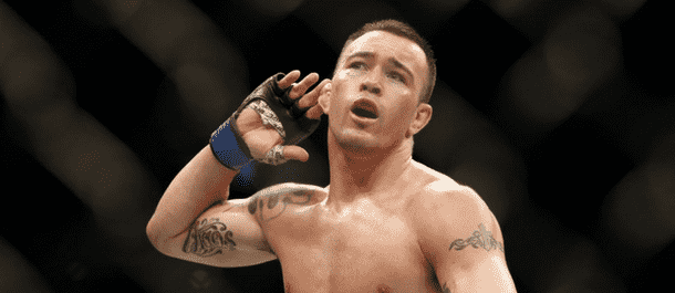 Colby Covington taunts the crowd after a UFC win