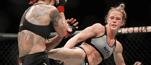 Holly Holm connects with a kick vs. Cris Cyborg
