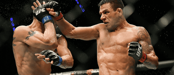 Rafael Dos Anjos connects with a spinning back fist