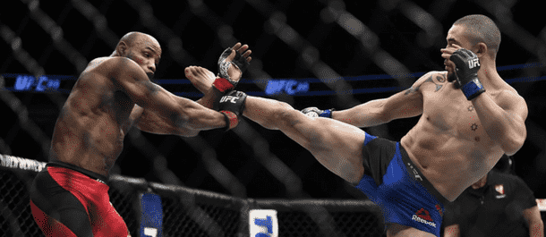 Robert Whittaker goes high with a kick against Yoel Romero