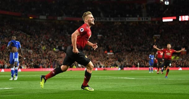 Luke Shaw scored his first senior goal as Manchester United won 2-1 at home to Leicester.