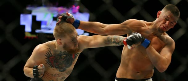Conor McGregor punches Nate Diaz during UFC 196