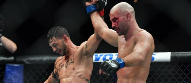 Artem Lobov and Cub Swanson raise their hands after a UFC main event war