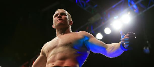 Misha Cirkunov climbs the UFC cage after securing an impressive victory