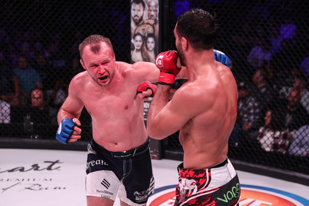 Alexander Shlemenko attempts to land a left hook on Gegard Mousasi
