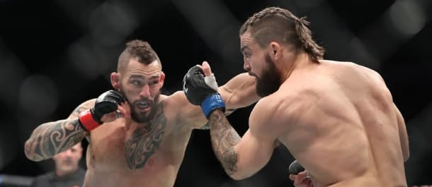 Santiago Ponzinibbio throws a left hand at Mike Perry