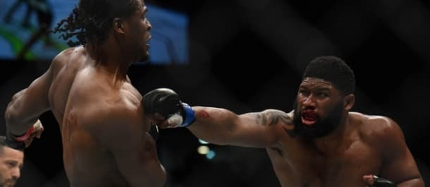 Curtis Blaydes throws a left hand at Francis Ngannou