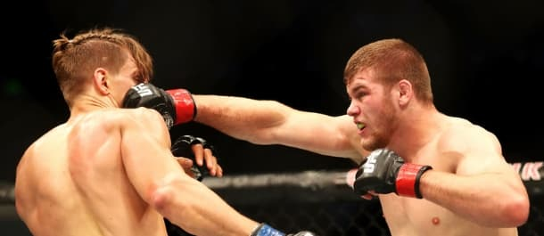 Jake Matthews lunges forward with a right punch in the UFC