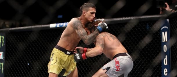 Charles Oliveira locks up a Thai clinch in the UFC