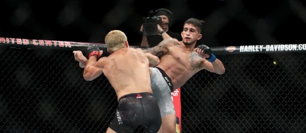 Sergio Pettis launches a right kick to the body