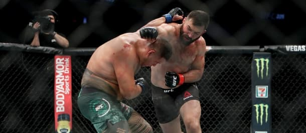 Andrei Arlovski throws a right hand at Tai Tuivasa in the UFC