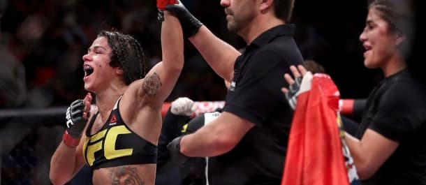 Claudia Gadelha has her hand raised after a dominant UFC victory